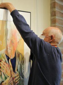 Robert Nelson Hanging a Watercolor